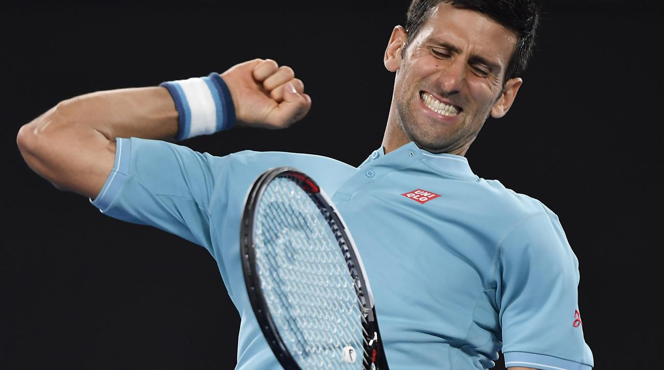 Serbia's Novak Djokovic celebrates after defeating Spain's Fernando Verdasco in their first round match at the Australian Open tennis championships in Melbourne, Australia, Tuesday, Jan. 17, 2017. (AP Photo/Andy Brownbill)