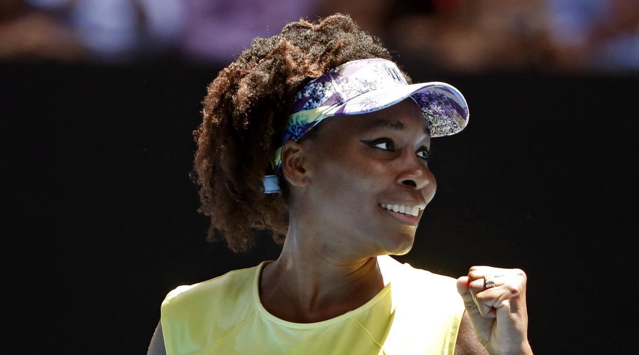 United States' Venus Williams celebrates a point win over Switzerland's Stefanie Voegele during their second round match at the Australian Open tennis championships in Melbourne, Australia, Wednesday, Jan. 18, 2017. (AP Photo/Dita Alangkara)