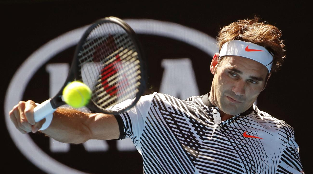 Switzerland's Roger Federer makes a backhand return to United States' Noah Rubin during their second round match at the Australian Open tennis championships in Melbourne, Australia, Wednesday, Jan. 18, 2017. (AP Photo/Dita Alangkara)