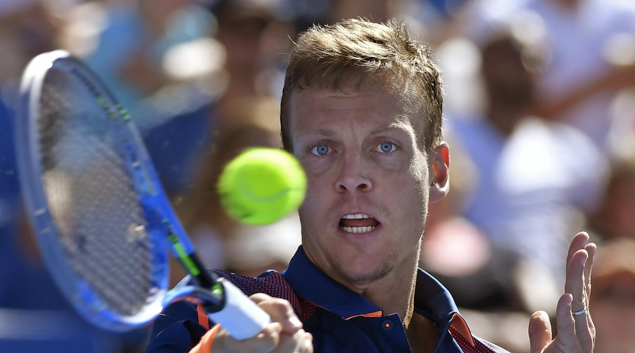 Tomas Berdych of the Czech Republic makes a forehand return to United States' Ryan Harrison during their second round match at the Australian Open tennis championships in Melbourne, Australia, Wednesday, Jan. 18, 2017. (AP Photo/Andy Brownbill)