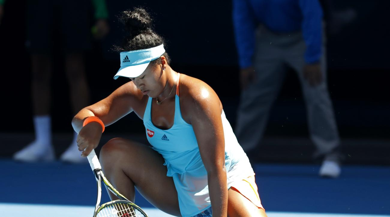 Japan's Naomi Osaka falls to the court while playing Britain's Johanna Konta during their second round match at the Australian Open tennis championships in Melbourne, Australia, Thursday, Jan. 19, 2017. (AP Photo/Kin Cheung)