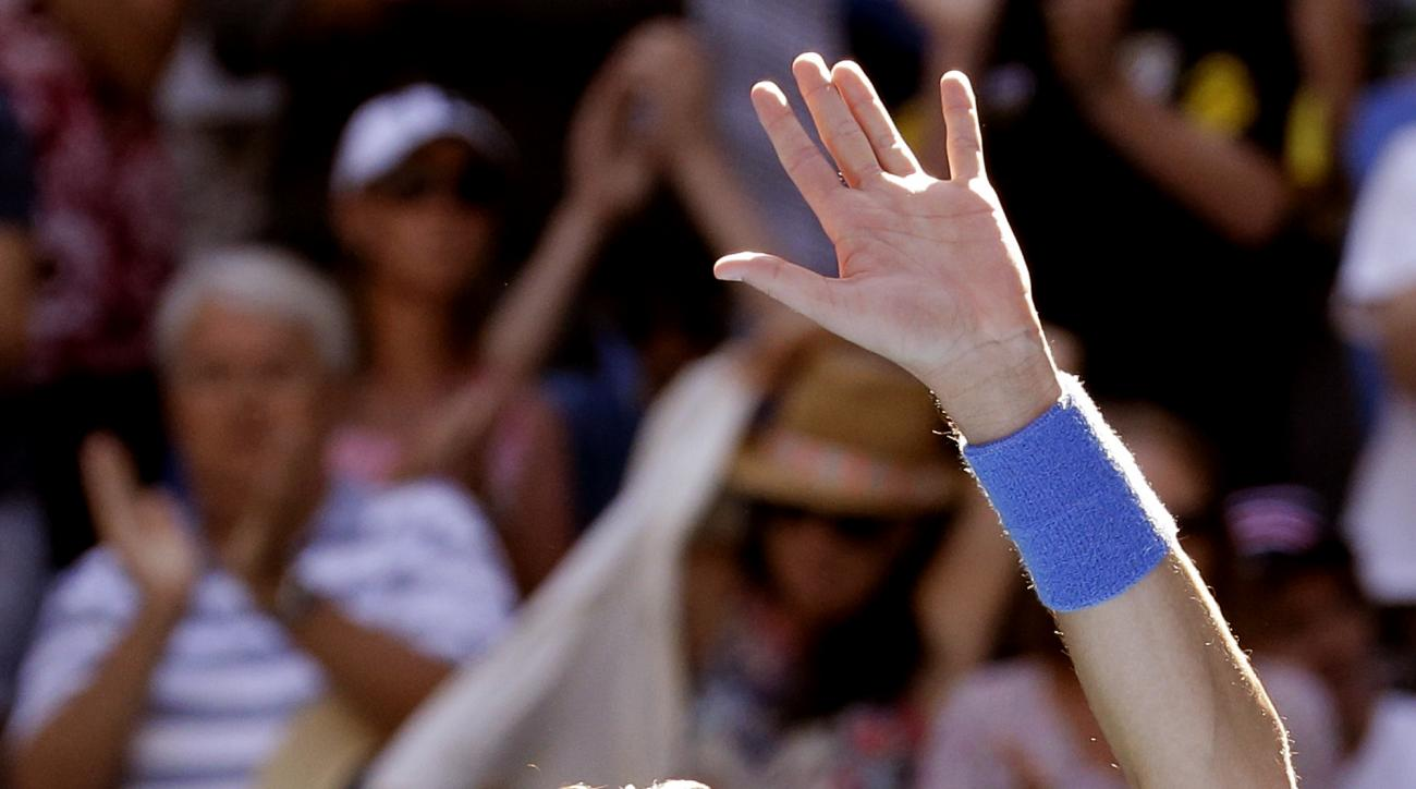 Canada's Milos Raonic waves to the spectators after defeating Luxembourg's Gilles Muller in their second round match at the Australian Open tennis championships in Melbourne, Australia, Thursday, Jan. 19, 2017. (AP Photo/Aaron Favila)