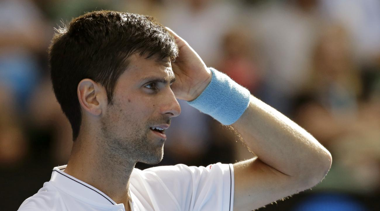 Serbia's Novak Djokovic reacts while playing Uzbekistan's Denis Istomin during their second round match at the Australian Open tennis championships in Melbourne, Australia, Thursday, Jan. 19, 2017. (AP Photo/Aaron Favila)