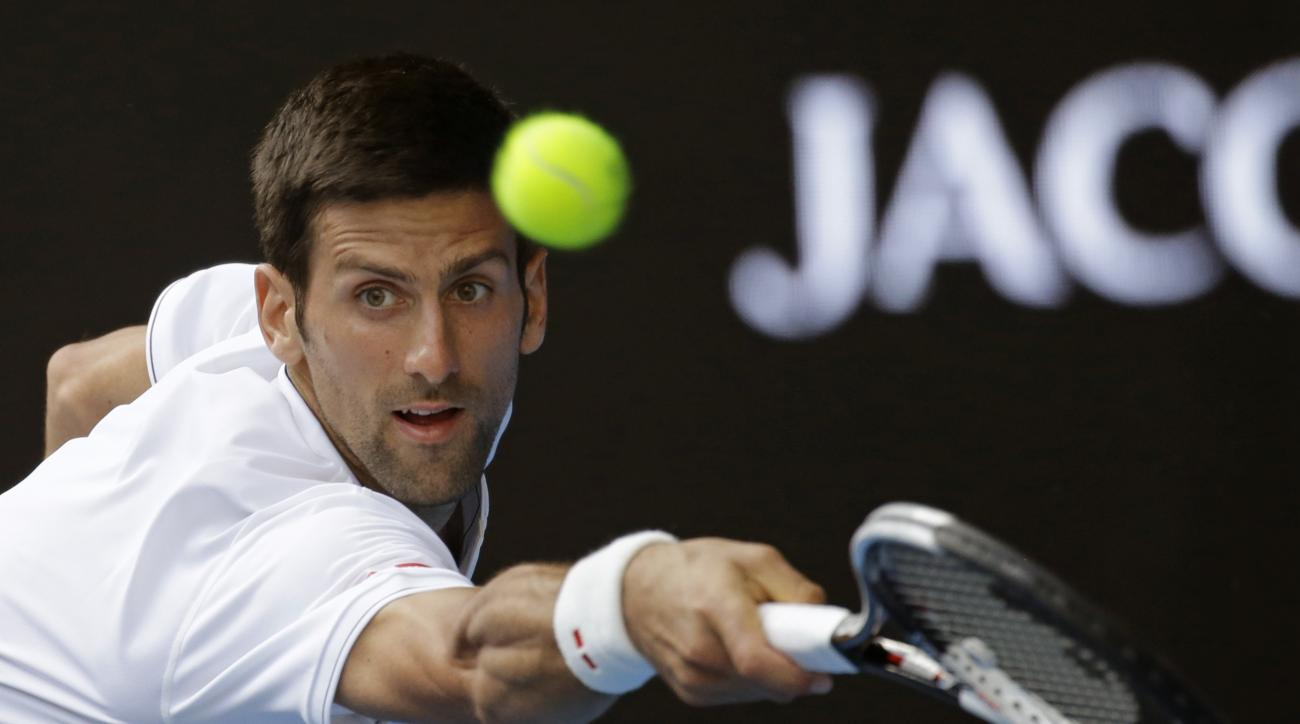 Serbia's Novak Djokovic reaches for a return to Uzbekistan's Denis Istomin during their second round match at the Australian Open tennis championships in Melbourne, Australia, Thursday, Jan. 19, 2017. (AP Photo/Aaron Favila)