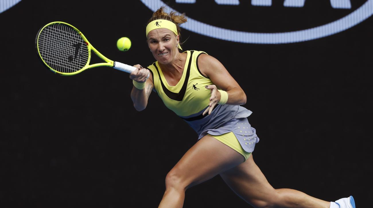 Russia's Svetlana Kuznetsova makes a forehand return to Serbia's Jelena Jankovic during their third round match at the Australian Open tennis championships in Melbourne, Australia, Friday, Jan. 20, 2017. (AP Photo/Kin Cheung)