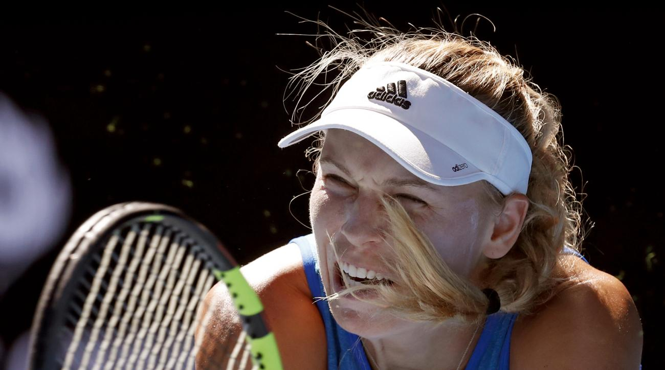 Denmark's Caroline Wozniacki makes a backhand return to Johanna Konta of Britain during their third round match at the Australian Open tennis championships in Melbourne, Australia, Saturday, Jan. 21, 2017. (AP Photo/Kin Cheung)