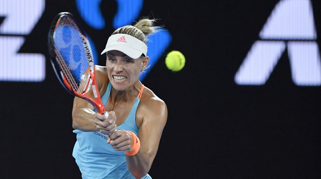 Germany's Angelique Kerber hits a backhand to United States' Coco Vandeweghe during their fourth round match at the Australian Open tennis championships in Melbourne, Australia, Sunday, Jan. 22, 2017. (AP Photo/Andy Brownbill)