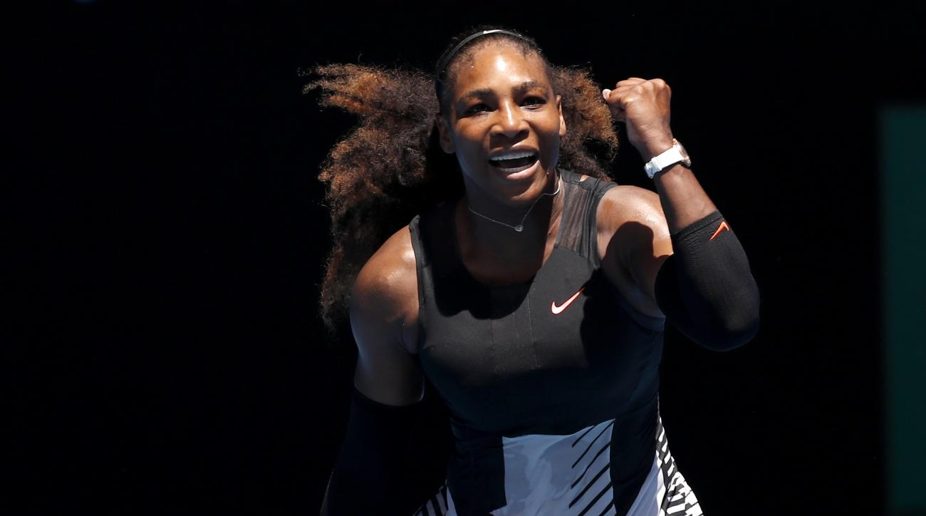 United States' Serena Williams celebrates after defeating Barbora Strycova of the Czech Republic in their fourth round match at the Australian Open tennis championships in Melbourne, Australia, Monday, Jan. 23, 2017. (AP Photo/Kin Cheung)