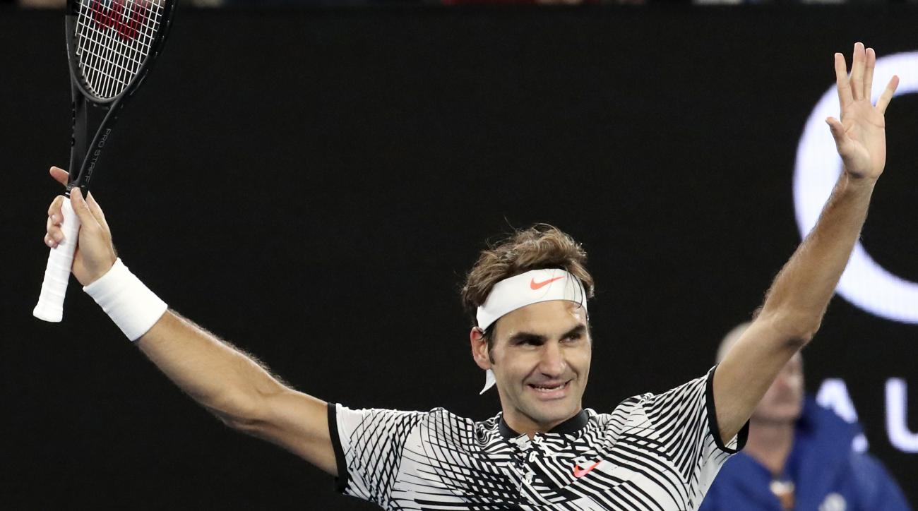 Switzerland's Roger Federer celebrates after defeating Germany's Mischa Zverev during their quarterfinal at the Australian Open tennis championships in Melbourne, Australia, Tuesday, Jan. 24, 2017. (AP Photo/Aaron Favila)
