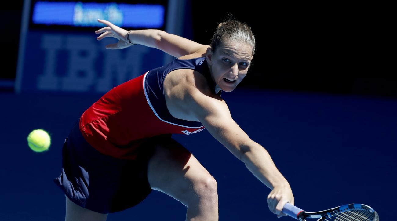 Karolina Pliskova of the Czech Republic makes a backhand return to Croatia's Mirjana Lucic-Baroni during their quarterfinal at the Australian Open tennis championships in Melbourne, Australia, Wednesday, Jan. 25, 2017. (AP Photo/Dita Alangkara)