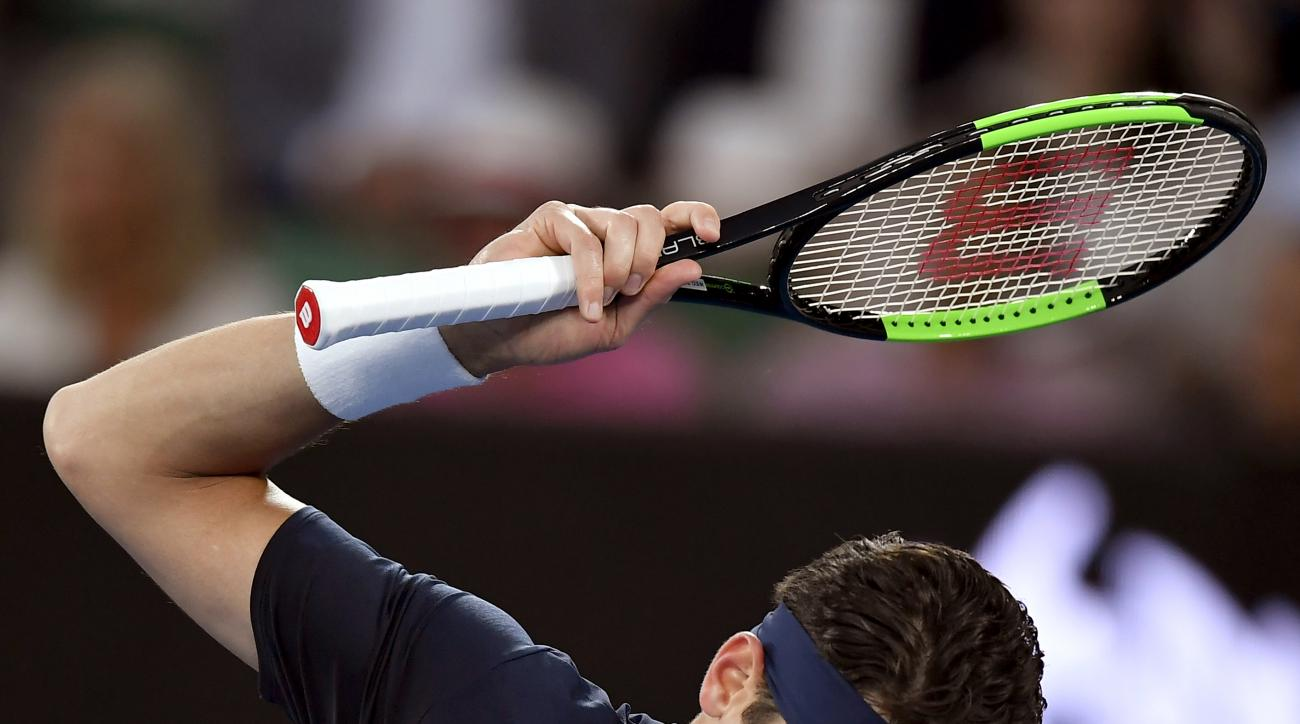 Canada's Milos Raonic attempts to throw a racket while playing Spain's Rafael Nadal during their quarterfinal at the Australian Open tennis championships in Melbourne, Australia, Wednesday, Jan. 25, 2017. (AP Photo/Andy Brownbill)