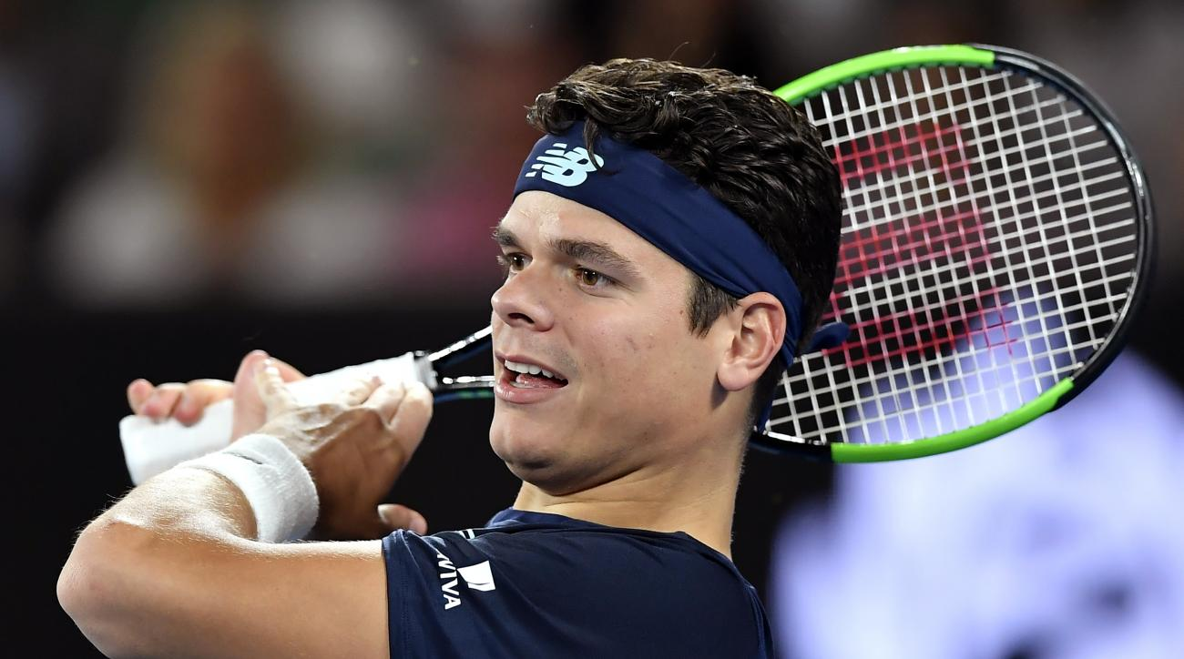 Canada's Milos Raonic follows through on a return to Spain's Rafael Nadal during their quarterfinal at the Australian Open tennis championships in Melbourne, Australia, Wednesday, Jan. 25, 2017. (AP Photo/Andy Brownbill)