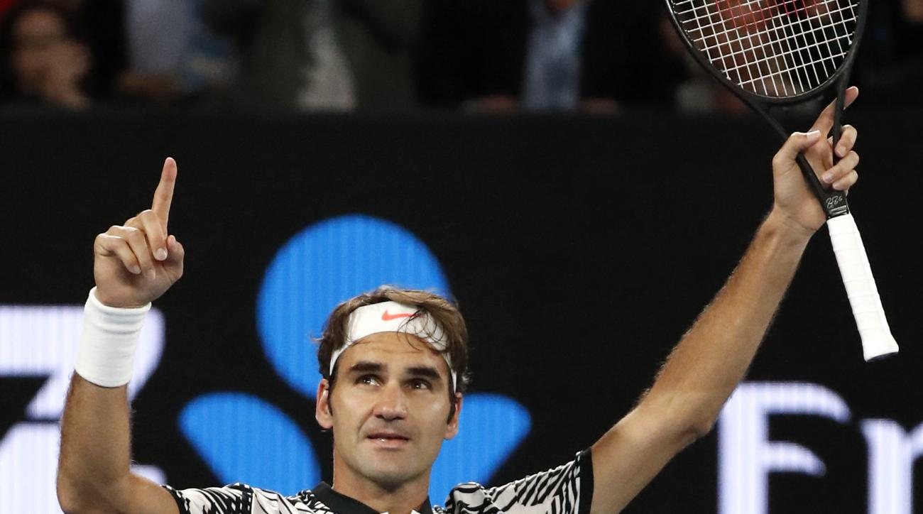 Switzerland's Roger Federer celebrates after defeating compatriot Stan Wawrinka during their semifinal at the Australian Open tennis championships in Melbourne, Australia, Thursday, Jan. 26, 2017. (AP Photo/Dita Alangkara)