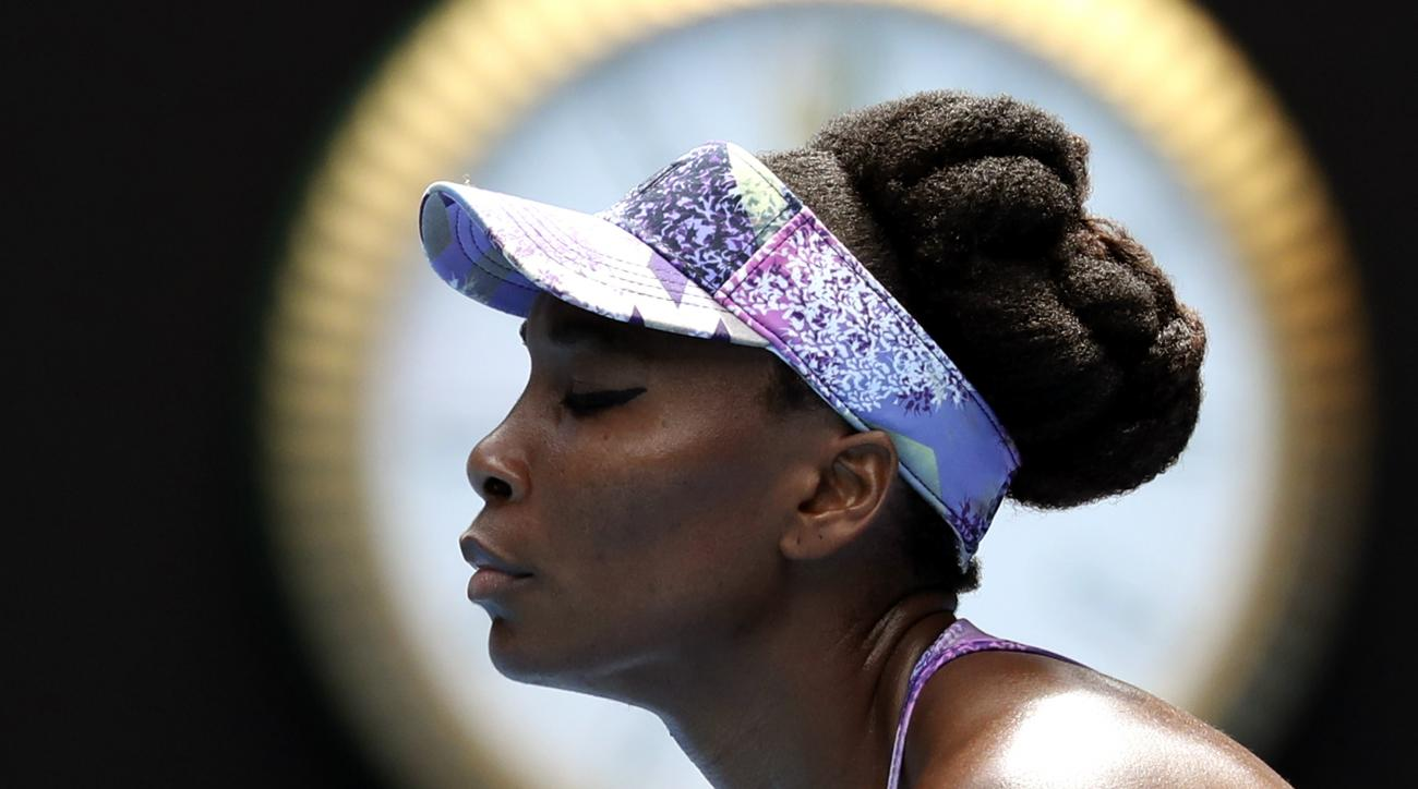 United States' Venus Williams pauses while playing compatriot Coco Vandeweghe during their semifinal at the Australian Open tennis championships in Melbourne, Australia, Thursday, Jan. 26, 2017. (AP Photo/Aaron Favila)