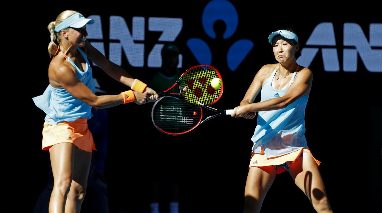 Andrea Hlavackova, left, of the Czech Republic and partner Peng Shuai of China hit a return during the women's doubles final against Bethanie Mattek-Sands of the U.S. and Lucie Safarova of the Czech Republic at the Australian Open tennis championships in