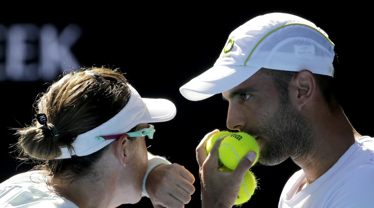 Abigail Speers of the US and Juan Sebastian Cabal of Colombia talk tactics in their mixed doubles' final against India's Sania Mirza and Ivan Dodig at the Australian Open tennis championships in Melbourne, Australia, Sunday, Jan. 29, 2017. (AP Photo/Aaron