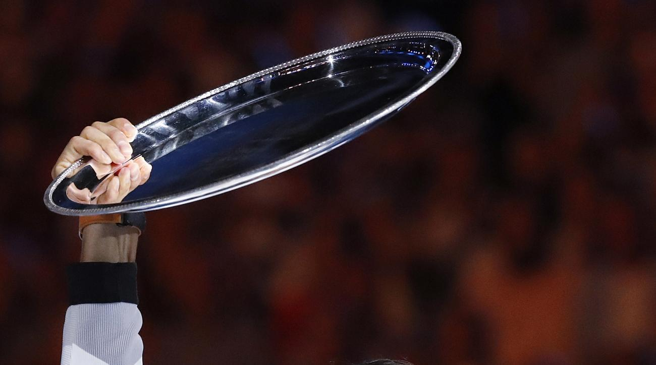 Spain's Rafael Nadal holds his runners-up trophy aloft after losing to Switzerland's Roger Federer in the men's singles final at the Australian Open tennis championships in Melbourne, Australia, Sunday, Jan. 29, 2017. (AP Photo/Kin Cheung)