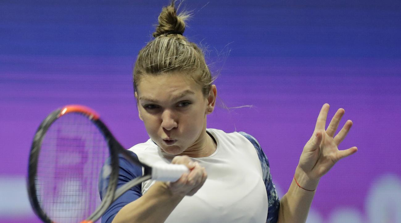 Simona Halep of Romania returns the ball to Ana Konjuh of Croatia during the St. Petersburg Ladies Trophy 2017 tennis tournament match in St.Petersburg, Russia, Wednesday, Feb. 1, 2017. (AP Photo/Dmitri Lovetsky)