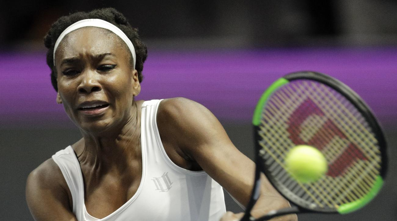 Venus Williams of U.S. returns the ball to Kristina Mladenovic of France during the St. Petersburg Ladies Trophy-2017 tennis tournament match in St.Petersburg, Russia, Thursday, Feb. 2, 2017. (AP Photo/Dmitri Lovetsky)
