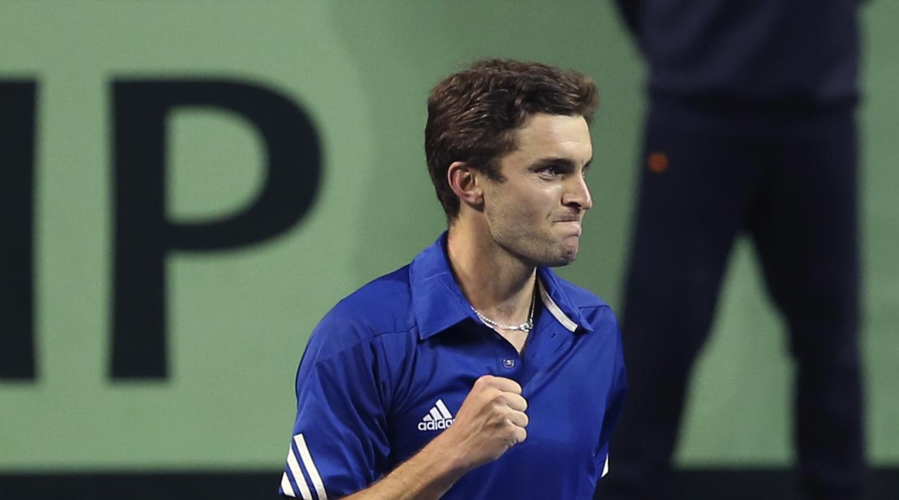 Gilles Simon of France celebrates after winning over Yoshihiko Nishioka of Japan during their Davis Cup World Group first round tennis match in Tokyo, Friday, Feb. 3, 2017. (AP Photo/Koji Sasahara)