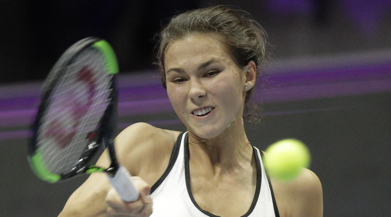 Russia's Natalia Vikhlyantseva returns the ball to France's Kristina Mladenovic, during the St. Petersburg Ladies Trophy-2017 tennis tournament semi final match in St.Petersburg, Russia, Saturday, Feb. 4, 2017. (AP Photo/Dmitri Lovetsky)
