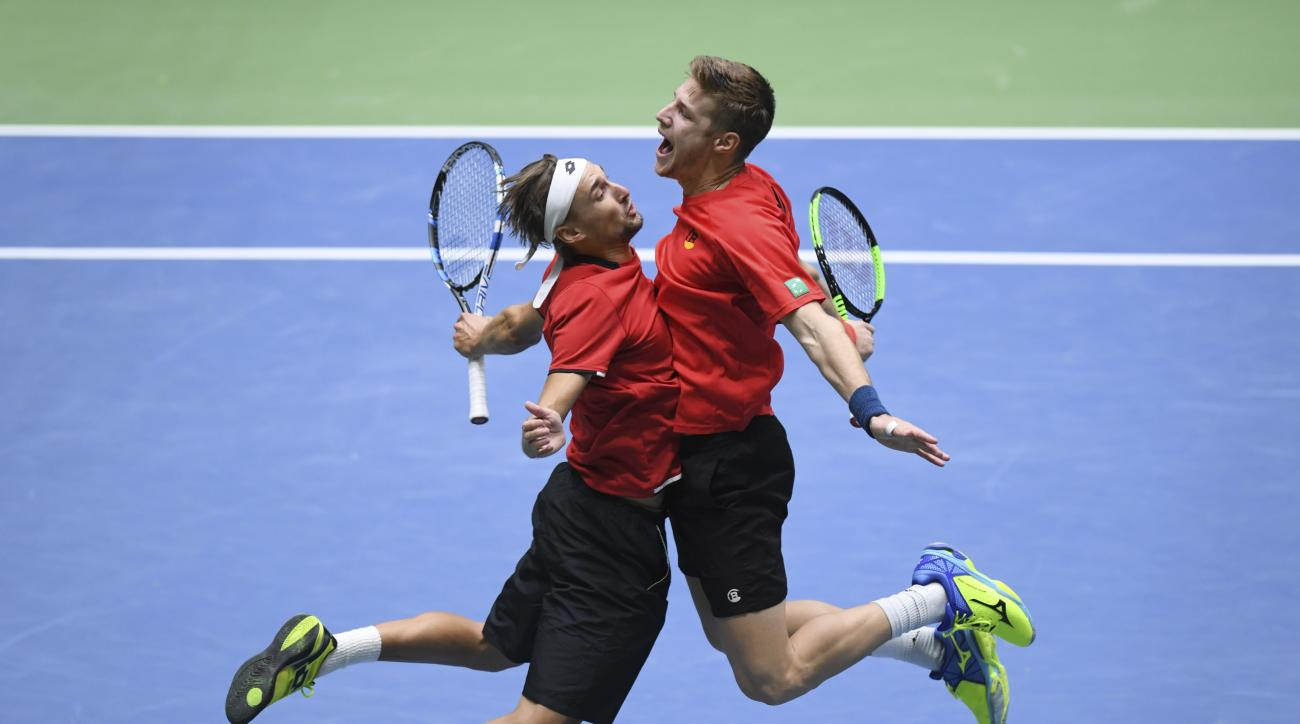 Belgium's  Joris De Loore, right, and Ruben Bemelmans celebrate  in their doubles match against Germany's Alexander and Mischa Zverev, during the Davis Cup first round match between Germany and Belgium in Frankfurt, Germany, Saturday Feb. 4, 2017.  Belgiu