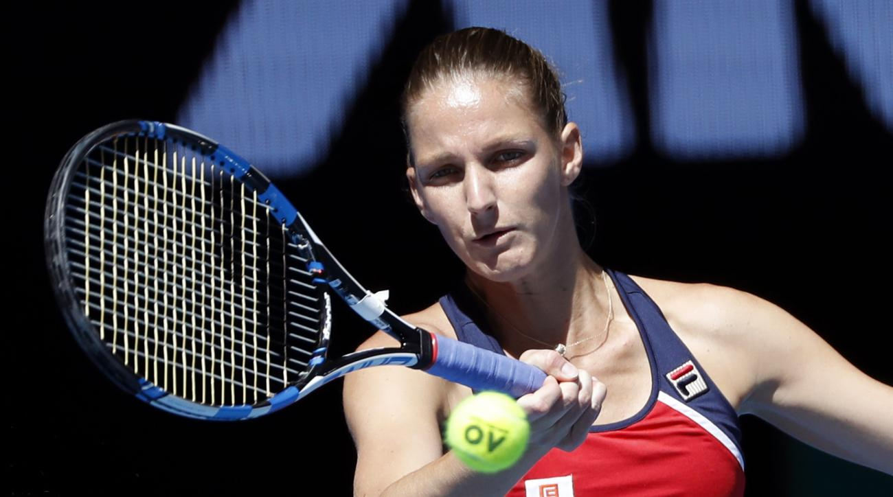 FILE - In this Wednesday, Jan. 25, 2017 file photo, Karolina Pliskova of the Czech Republic makes a forehand return to Croatia's Mirjana Lucic-Baroni during their quarterfinal at the Australian Open tennis championships in Melbourne, Australia. World No.3