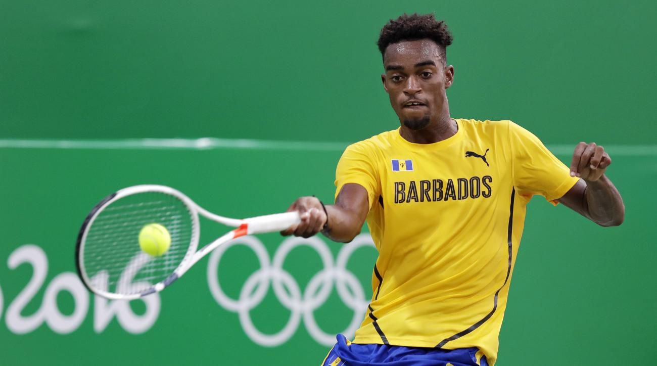 Darian King, of Barbados, returns to Steve Johnson, of the United States, at the 2016 Summer Olympics in Rio de Janeiro, Brazil, Saturday, Aug. 6, 2016. (AP Photo/Charles Krupa)