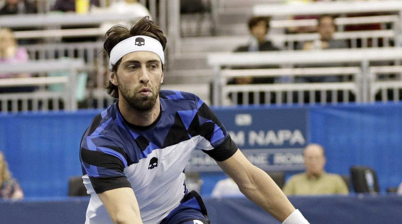 Nikoloz Basilashvili, of Georgia, returns a shot to Mikhail Kukushkin in a semifinal at the Memphis Open tennis tournament Saturday, Feb. 18, 2017, in Memphis, Tenn. (AP Photo/Mark Humphrey)