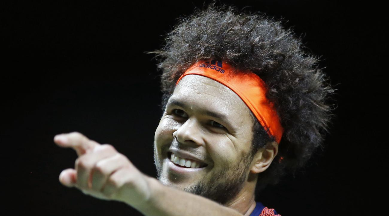 France's Jo-Wilfried Tsonga celebrates winning his match against Belgium's David Goffin in three sets, 4-6, 6-4, 6-1, in the men's singles final of the ABN AMRO world tennis tournament at the Ahoy stadium in Rotterdam, Netherlands, Sunday, Feb. 19, 2017.