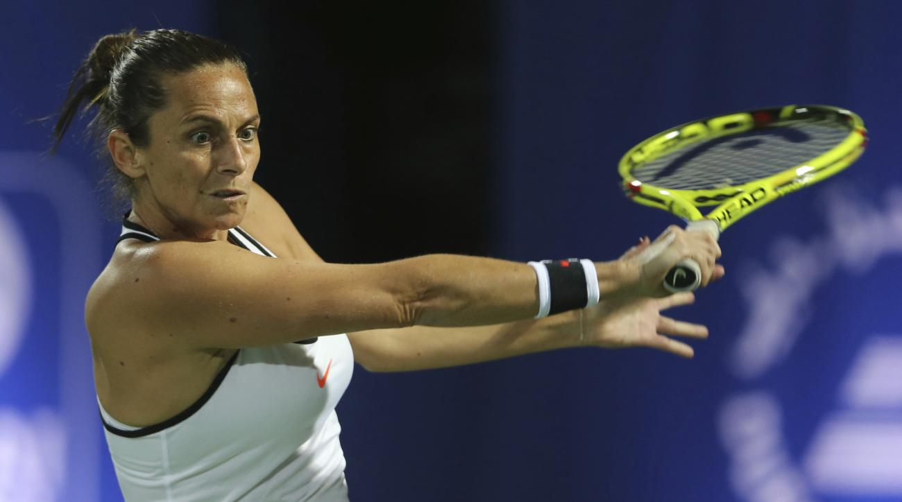 Roberta Vinci of Italy returns the ball to Kristyna Pliskova of the Czech Republic during the Dubai Tennis Championships, in Dubai, United Arab Emirates, Sunday, Feb. 19, 2017. (AP Photo/Kamran Jebreili)