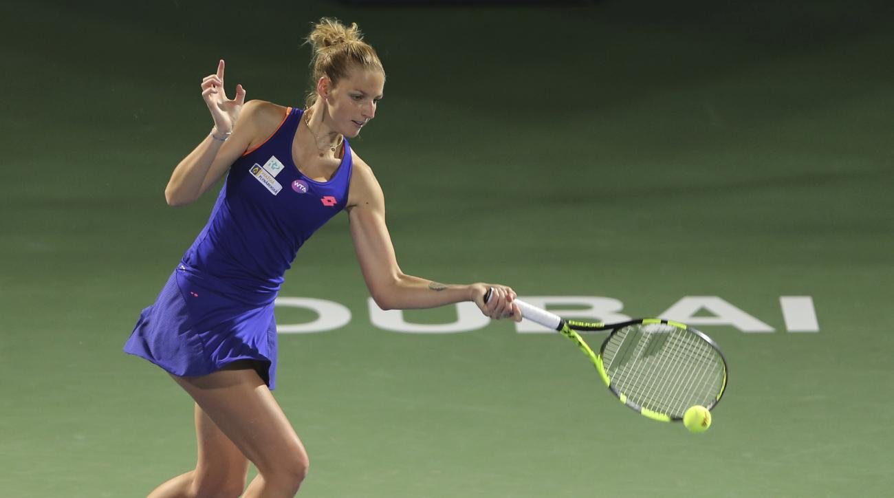 Kristyna Pliskova of Czech Republic returns the ball to Roberta Vinci of Italy during the Dubai Tennis Championships, in Dubai, United Arab Emirates, Sunday, Feb. 19, 2017. (AP Photo/Kamran Jebreili)