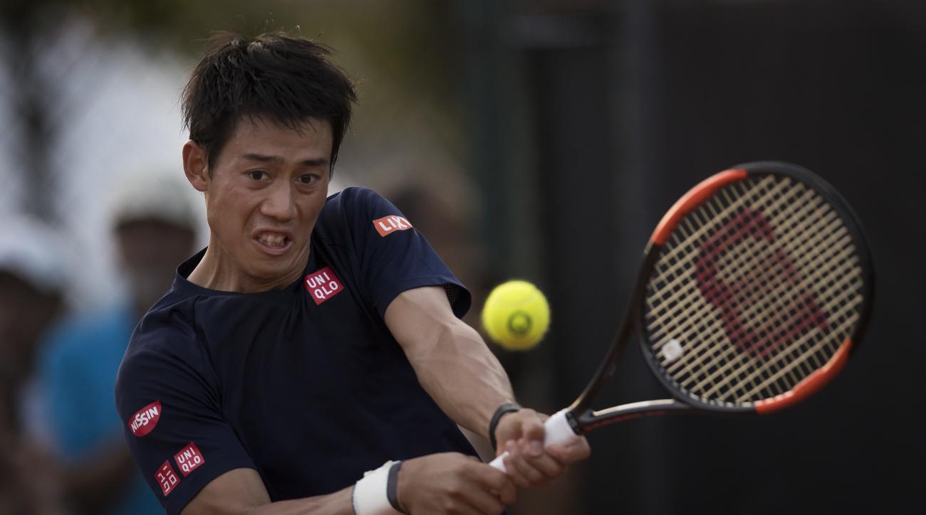 Japan's Kei Nishikori returns the ball during a practice session of the Rio Open tennis tournament in Rio de Janeiro, Brazil, Monday, Feb. 20, 2017. (AP Photo/Felipe Dana)