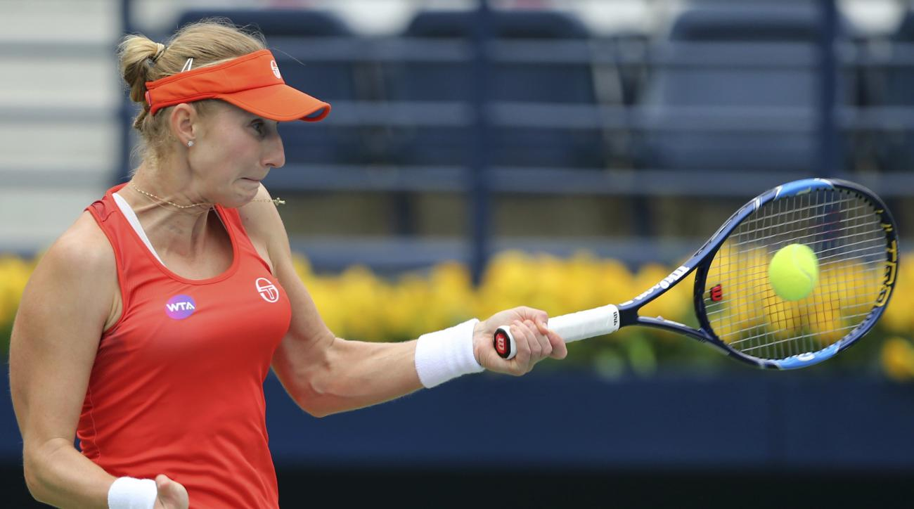 Ekaterina Makarova of Russia returns the ball to Dominika Cibulkova of Slovakia during the Dubai Tennis Championships in Dubai, United Arab Emirates, Tuesday, Feb. 21, 2017. (AP Photo/Kamran Jebreili)