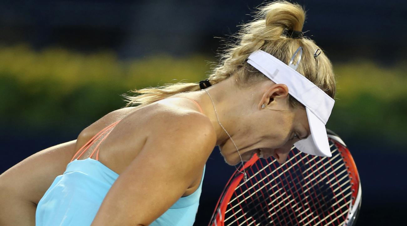 Angelique Kerber of Germany celebrates after she scoring a point against Monica Puig of Puerto Rico, during the Dubai Tennis Championships, in Dubai, United Arab Emirates, Wednesday, Feb. 22, 2017. (AP Photo/Kamran Jebreili)