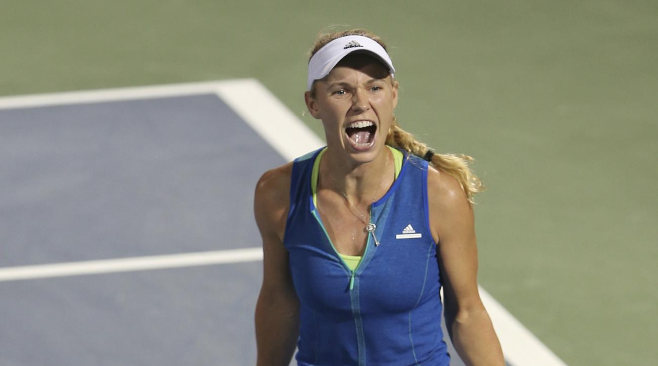 Caroline Wozniacki of Denmark celebrates after she beats Anastasija Sevastova of Latvia during a semi final match of the Dubai Tennis Championships in Dubai, United Arab Emirates, Friday, Feb. 24, 2017. (AP Photo/Kamran Jebreili)