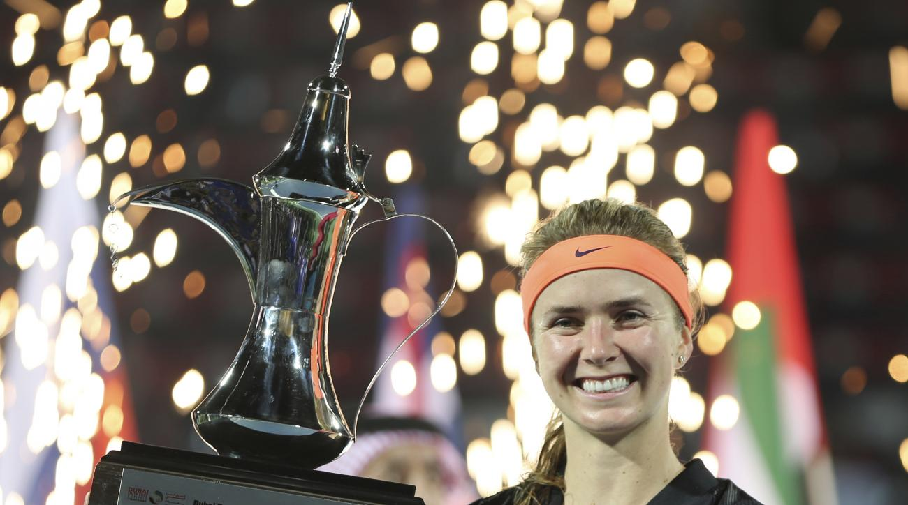 Elina Svitolina of Ukraine holds the trophy after she defeated Caroline Wozniacki of Denmark in the final match of the Dubai Tennis Championships in Dubai, United Arab Emirates, Saturday, Feb. 25, 2017. (AP Photo/Kamran Jebreili)