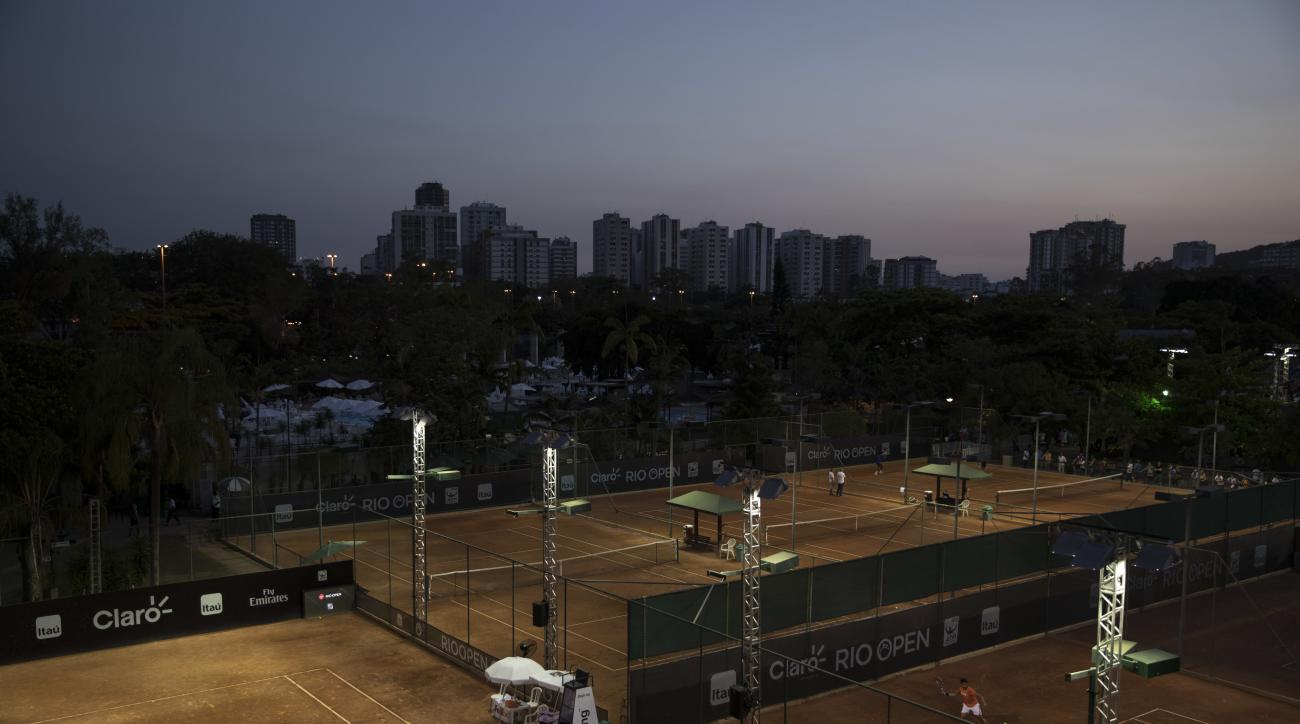 In this Feb. 23, 2017 photo, tennis players practice at the Rio Open tennis tournament in Rio de Janeiro, Brazil. The days of clay-court tennis in Latin America are numbered. The clay-court circuit lost a major event several years ago when this weeks Mexi