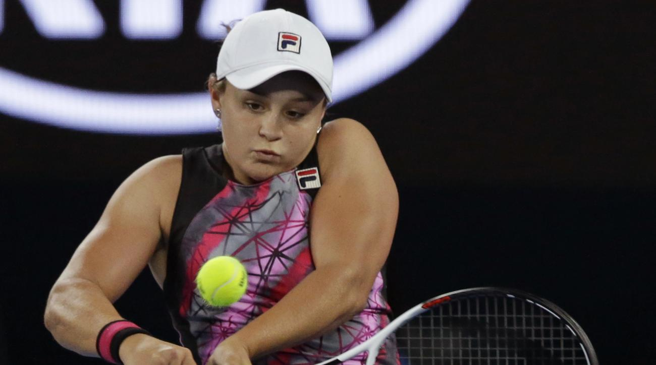 Australia's Ashleigh Barty makes a backhand return to Germany's Mona Barthel during their third round match at the Australian Open tennis championships in Melbourne, Australia, Friday, Jan. 20, 2017. (AP Photo/Dita Alangkara)