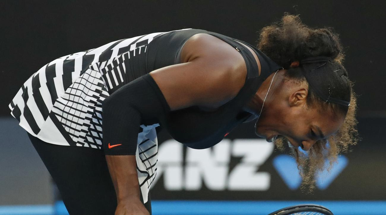 United States' Serena Williams smashes her racket during her match against her sister Venus in the women's singles final at the Australian Open tennis championships in Melbourne, Australia, Saturday, Jan. 28, 2017. (AP Photo/Kin Cheung)