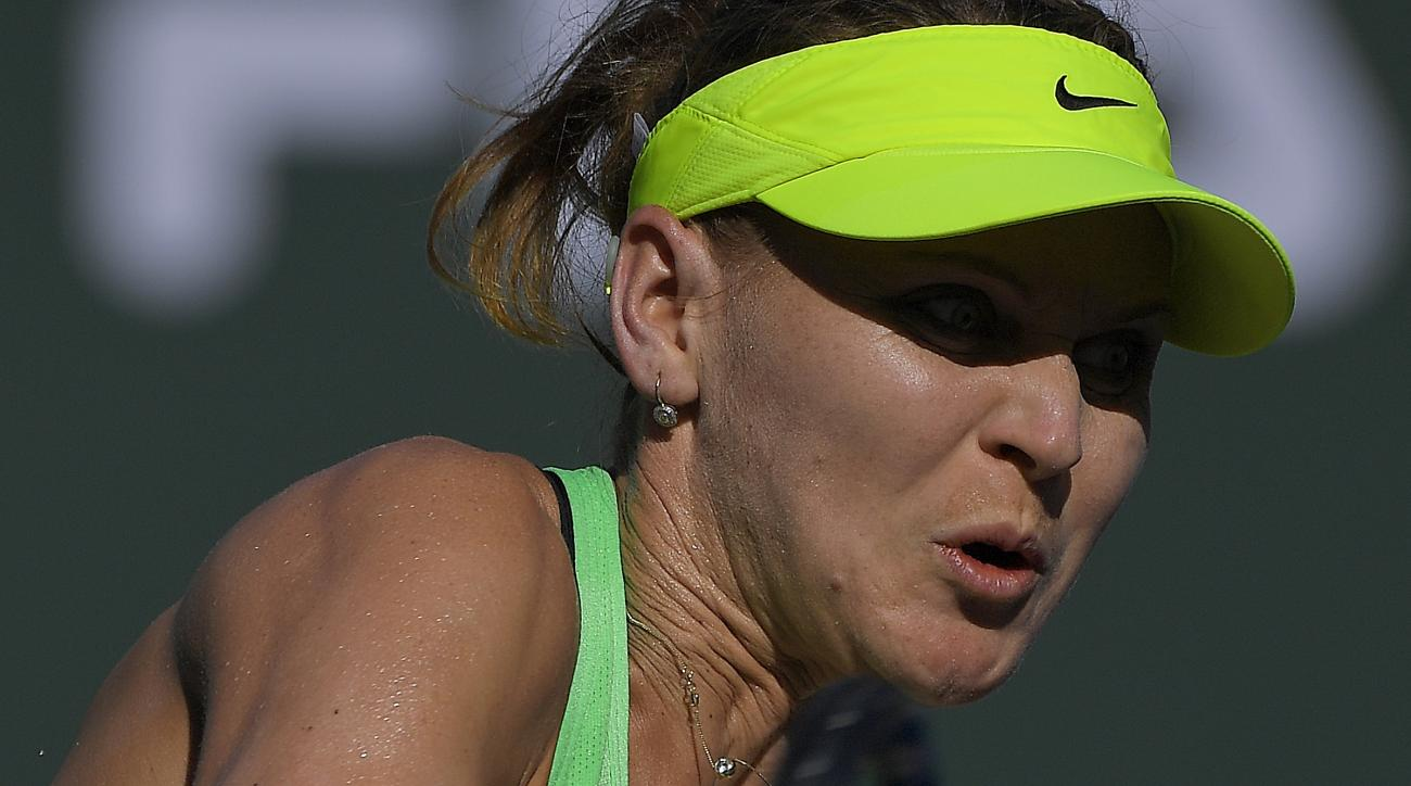 Lucie Safarova, of the Czech Republic, returns a shot to Venus Williams at the BNP Paribas Open tennis tournament, Monday, March 13, 2017, in Indian Wells, Calif. (AP Photo/Mark J. Terrill)