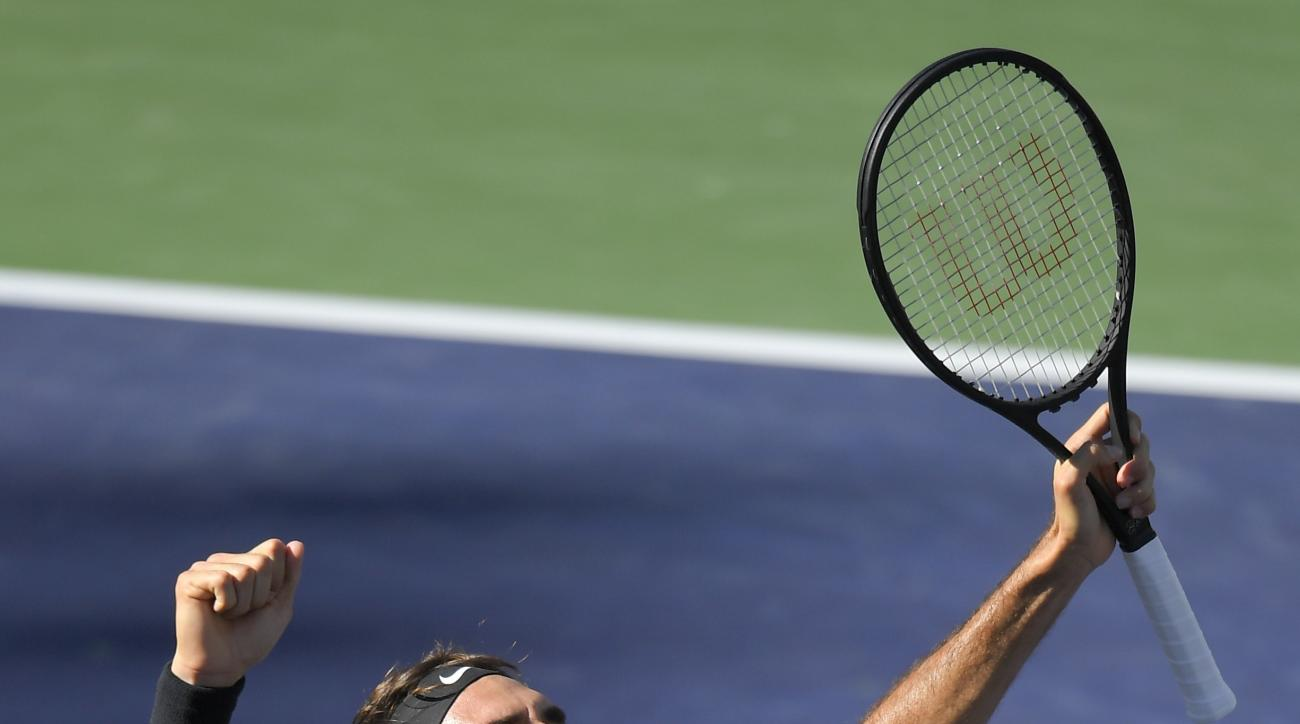 Roger Federer, of Switzerland, celebrates his win against Stanislas Wawrinka, of Switzerland, in their final match at the BNP Paribas Open tennis tournament, Sunday, March 19, 2017, in Indian Wells, Calif. (AP Photo/Mark J. Terrill)