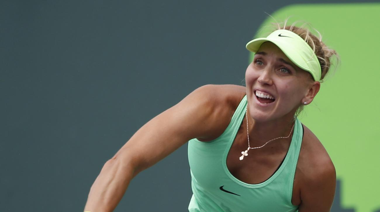 Elena Vesnina, of Russia, serves to Ajla Tomljanovic, of Croatia, during a tennis match at the Miami Open, Friday, March 24, 2017 in Key Biscayne, Fla. (AP Photo/Wilfredo Lee)