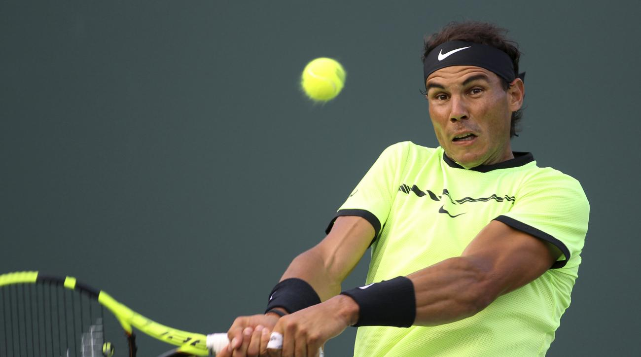 Rafael Nadal, of Spain, returns the ball to Philipp Kohlschreiber, of Germany, during the Miami Open tennis tournament, Sunday, March 26, 2017, in Key Biscayne, Fla. Nadal won 0-6, 6-2, 6-3. (AP Photo/Luis M. Alvarez)