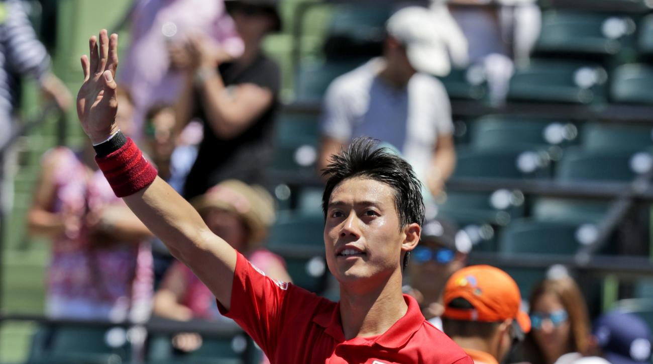Kei Nishikori, of Japan, waves after defeating Federico Delbonis at the Miami Open tennis tournament, Tuesday, March 28, 2017, in Key Biscayne, Fla. Nishikori won 6-3, 4-6, 6-3. (AP Photo/Lynne Sladky)