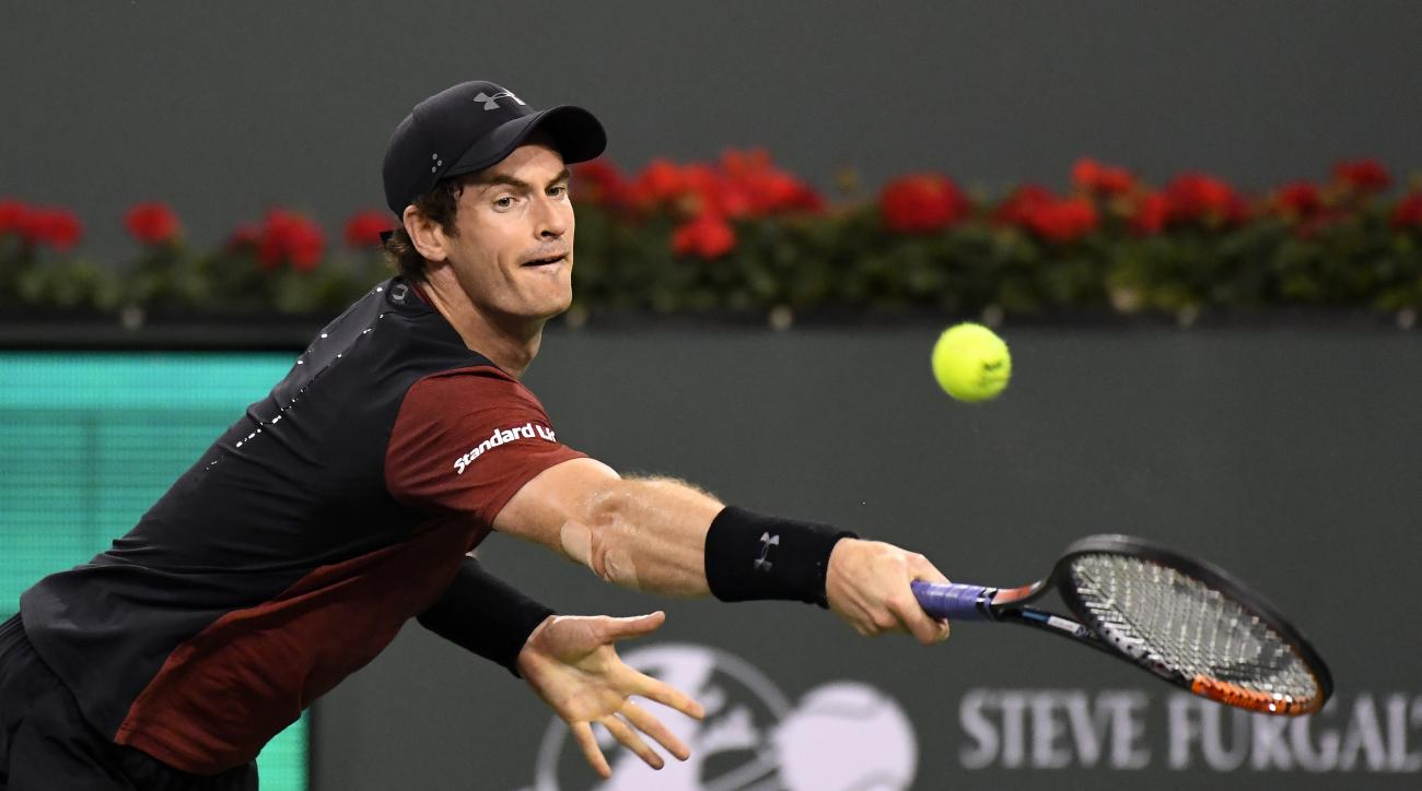 FILE - In this Saturday, March 11, 2017 file photo, Andy Murray, of Great Britain, returns a shot to Vasek Pospisil, of Canada, at the BNP Paribas Open tennis tournament in Indian Wells, Calif. France captain Yannick Noah has warned home fans against thin