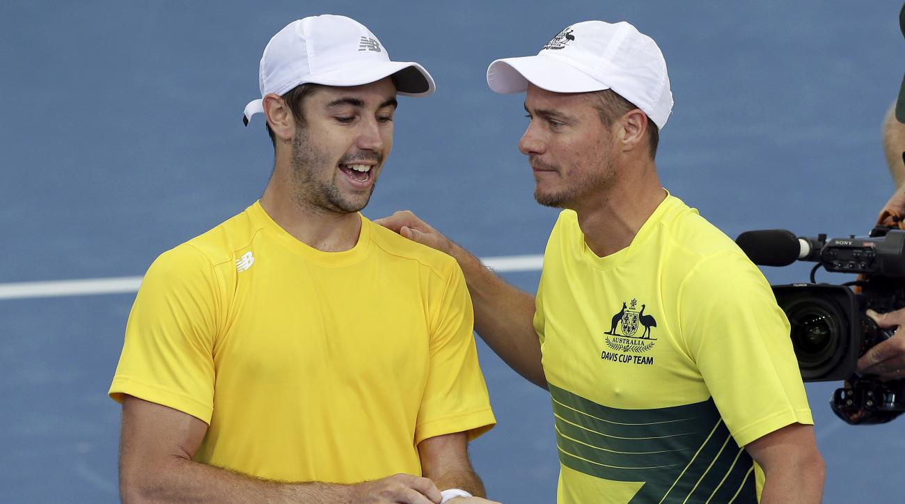 Australian captain Lleyton Hewitt, right, celebrates with Jordan Thompson of Australia after he won over Jack Sock of the U.S. at the Davis Cup World Group Quarterfinal in Brisbane, Australia, Friday, April 7, 2017. (AP Photo/Tertius Pickard)
