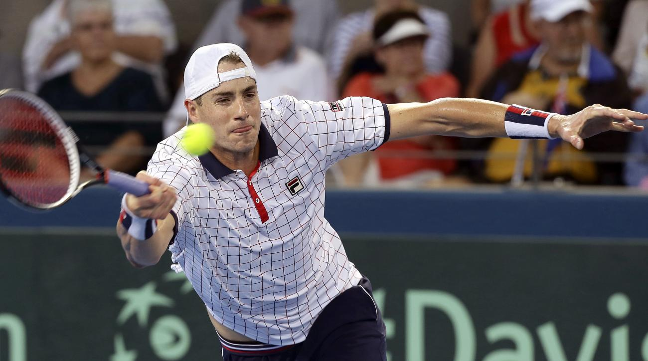 John Isner of the U.S. plays a shot in his match against Nick Kyrgios of Australia at the Davis Cup World Group Quarterfinal in Brisbane, Australia, Friday, April 7, 2017. (AP Photo/Tertius Pickard)