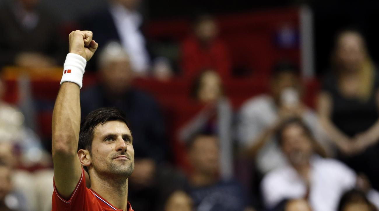 Serbia's Novak Djokovic celebrates after having won his Davis Cup quarterfinal tennis match against Spain's Albert Ramos-Vinolas, in Belgrade, Serbia, Friday, April 7, 2017. (AP Photo/Darko Vojinovic)