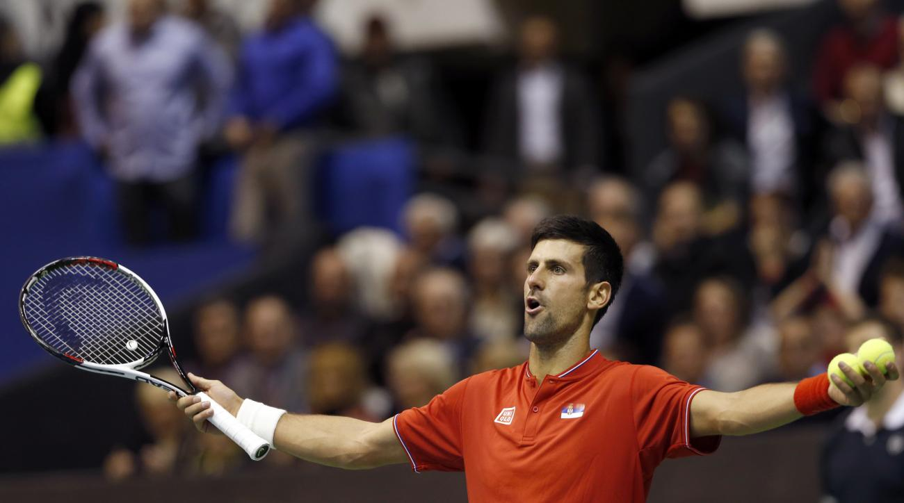Serbia's Novak Djokovic reacts during their Davis Cup quarterfinal tennis match against Spain's Albert Ramos-Vinolas, in Belgrade, Serbia, Friday, April 7, 2017. (AP Photo/Darko Vojinovic)